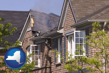 house fire damage with a smoldering roof - with New York icon
