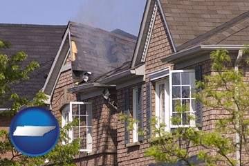 house fire damage with a smoldering roof - with Tennessee icon