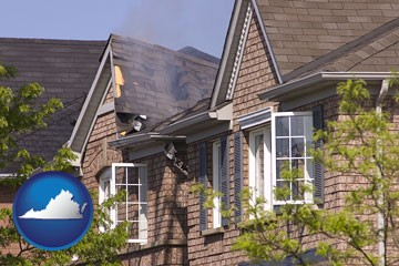 house fire damage with a smoldering roof - with Virginia icon