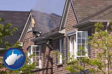 house fire damage with a smoldering roof - with West Virginia icon